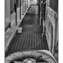 Untitled (Alley and Cyclist) (black and white photograph)