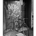Bicycle, Graffiti and Litter, in Morning Light (black and white photograph)