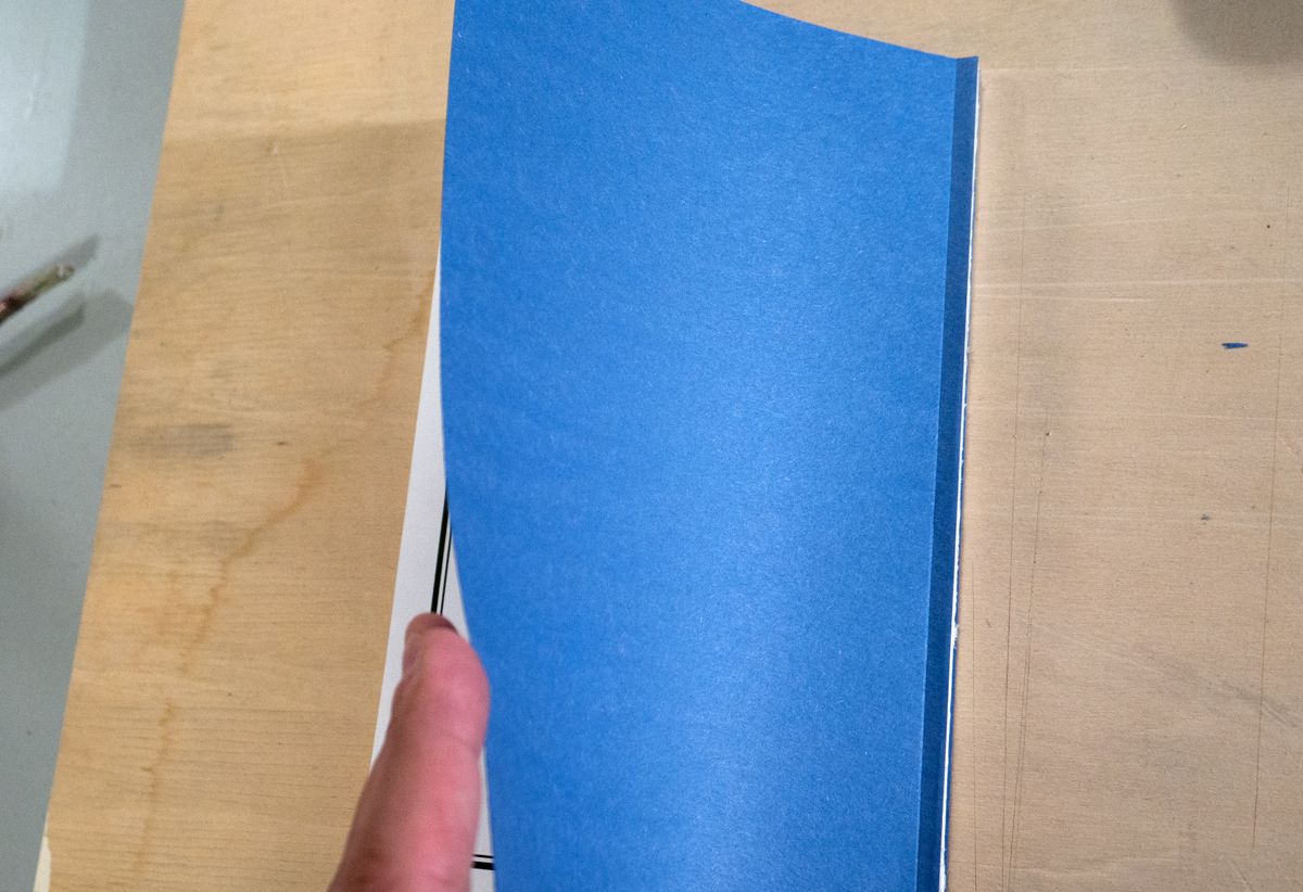 A blue endpaper of my book, glued to the cover