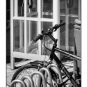 Bicycle and Phone Booth (black and white photograph)