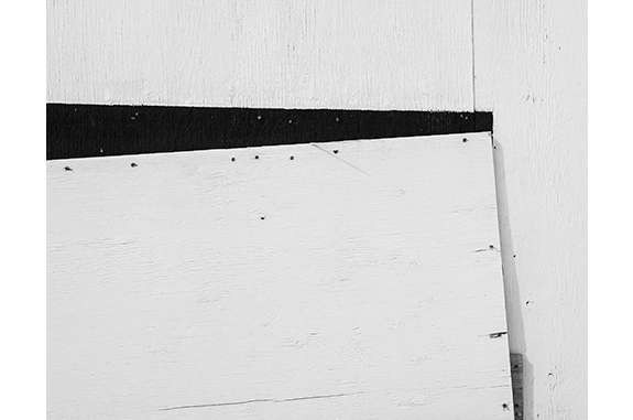 Construction Site Boarded Wall (black and white photograph)