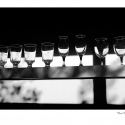 Drinking Glasses and Shadows (black and white photograph)