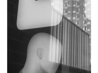 Mannequin Head and Window Reflections (black and white photograph)