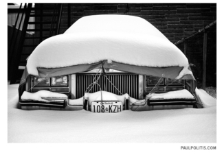 Snow on Car (black and white photograph)