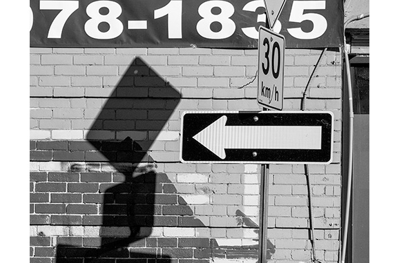 Street Signs and Arrows (black and white photograph)