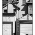 Untitled (dog and houses) (black and white photograph)